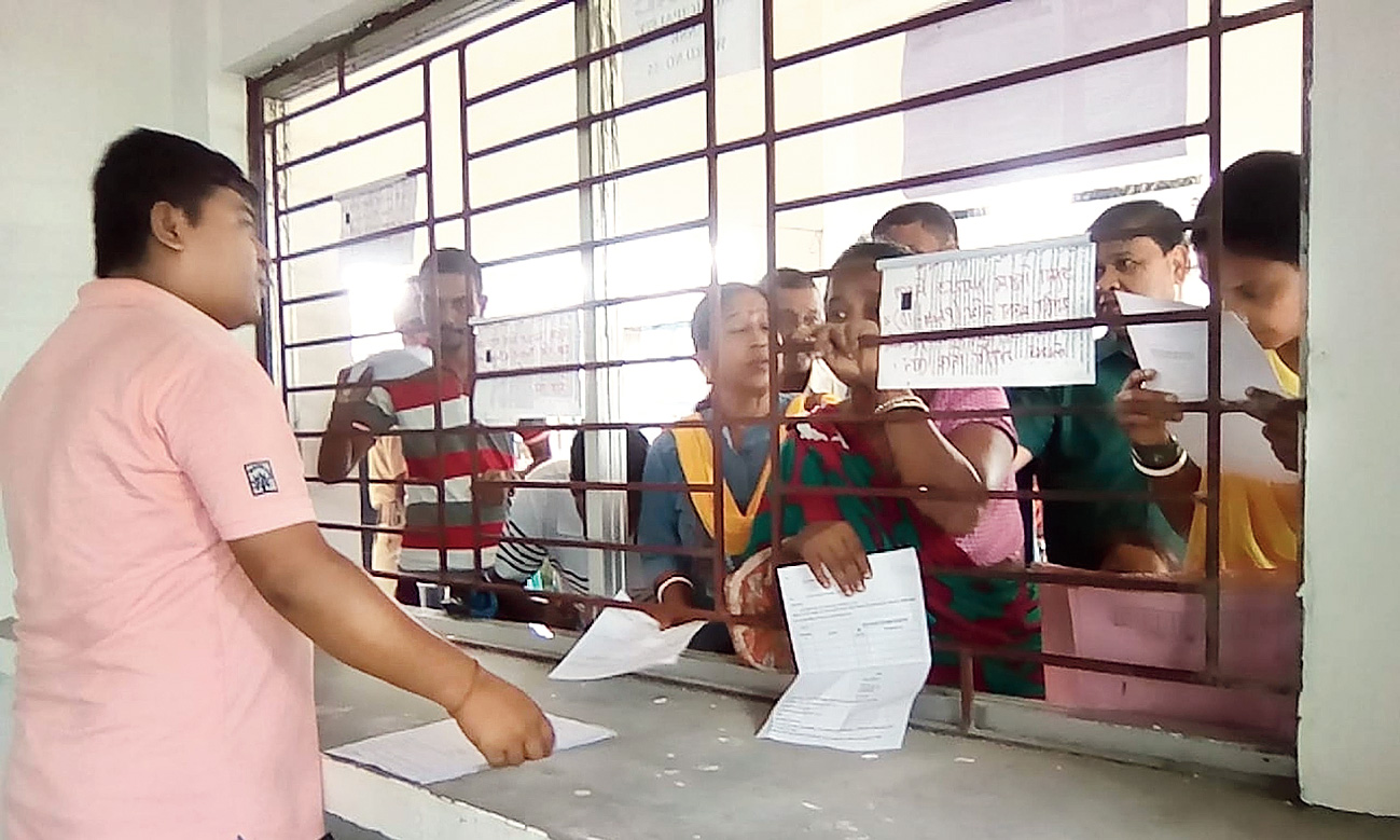 Applicants submit claims forms at an NRC seva kendra in Dibrugarh.