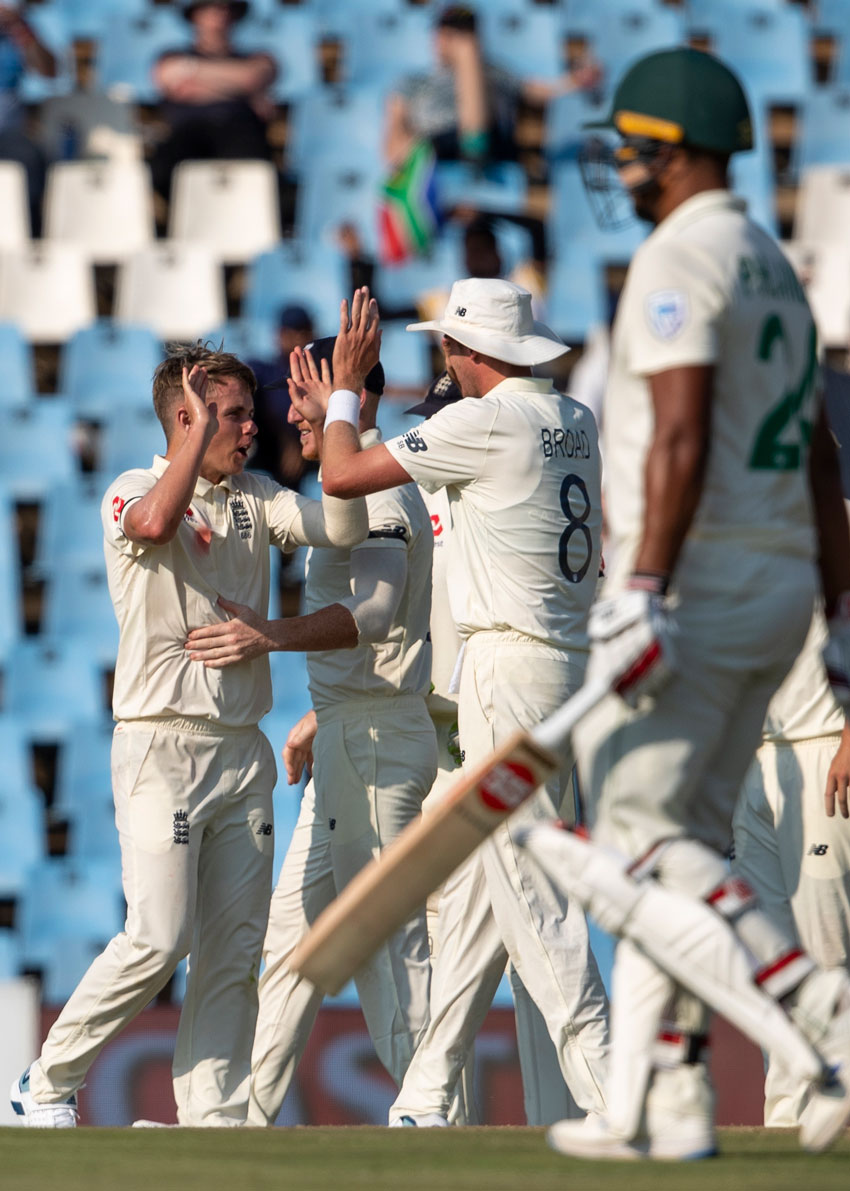 England's bowler Sam Curran, left, celebrates with teammates after dismissing South Africa's batsman Quinton de Kock for 95 runs on day one of the first cricket test match between South Africa and England at Centurion Park, Pretoria, South Africa, Thursday