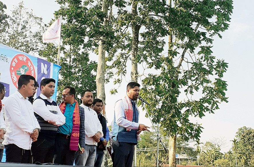 AASU general secretary Lurinjyoti Gogoi addresses an anti-CAA rally under an avenue of trees in Upper Assam