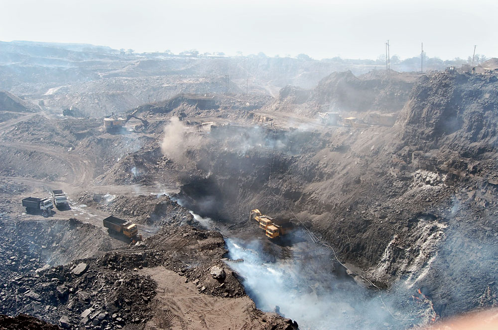 Smoke and dust emanate from BCCL's Rajapur Colliery in Dhanbad on Tuesday