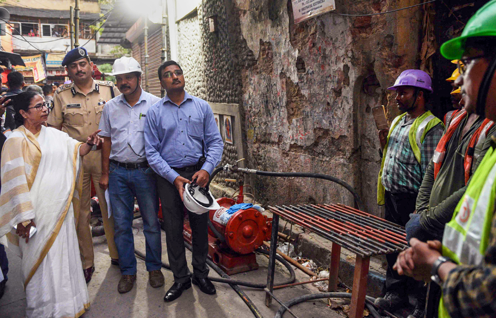West Bengal Chief Minister Mamata Banerjee interacts with technicians at Bowbazar area, Calcutta on Monday, September 2, 2019.