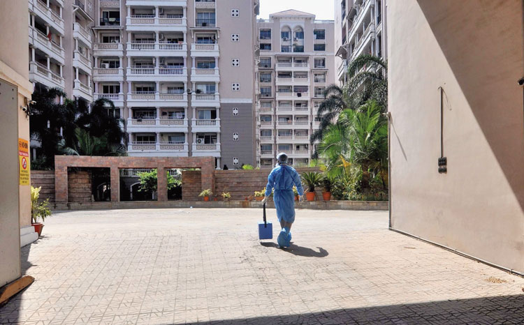 A health worker enters Spanish Garden complex to collect blood samples of residents on Sunday.