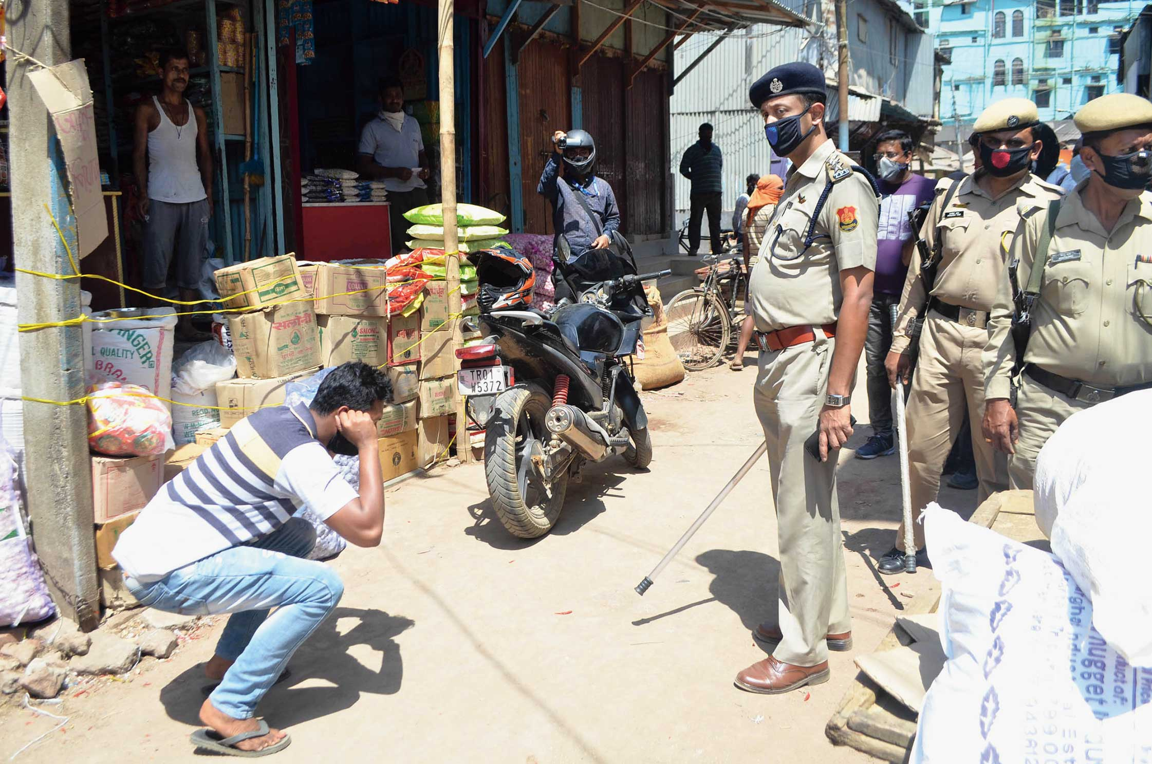 Police personal stop commuters during the lockdown in Agartala.