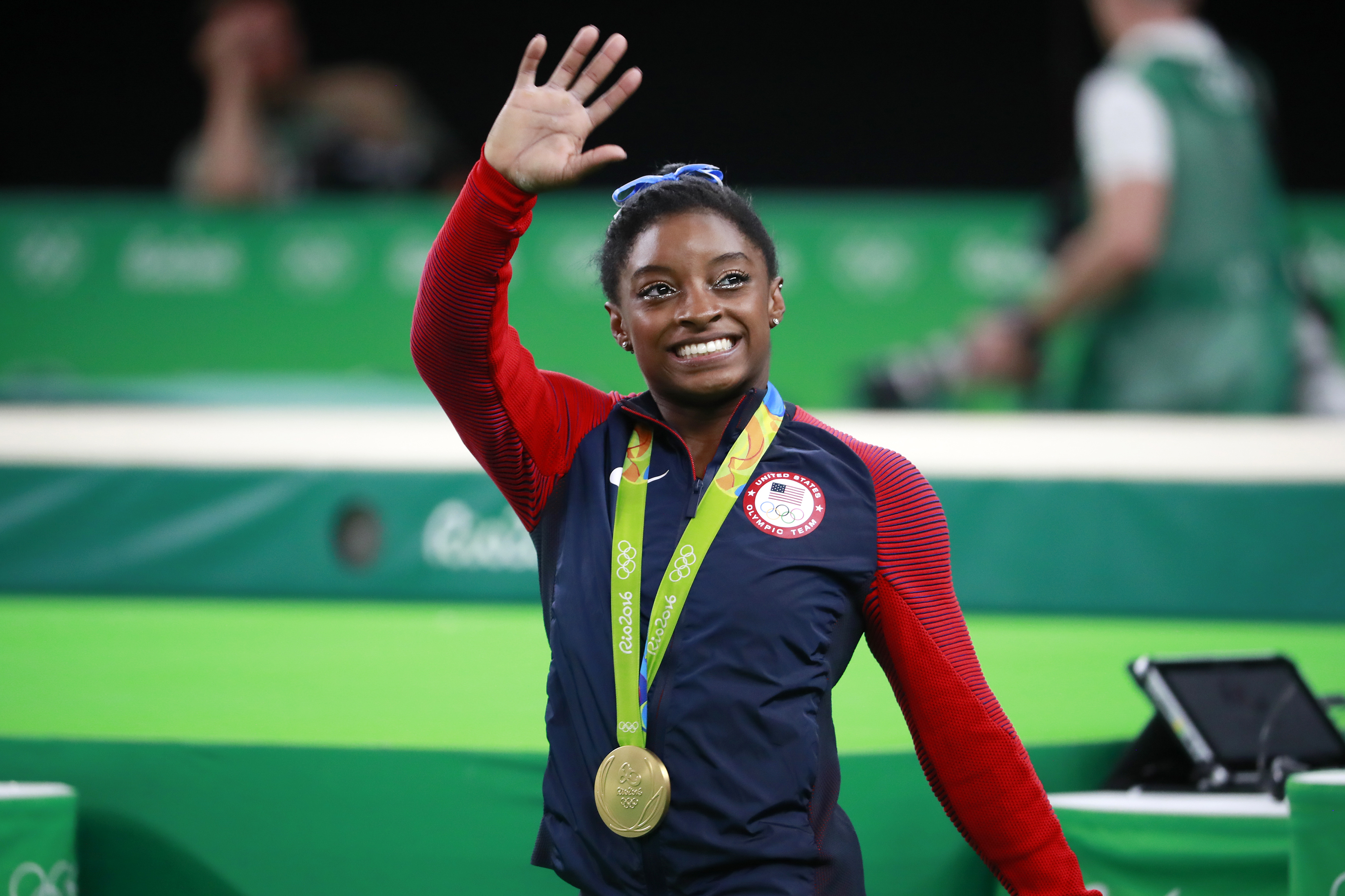 In this file photo, Simone Biles of the US, waves at the crowd at the Olympic Arena during the 2016 Summer Olympics, where she won four gold medals, in Rio de Janeiro, August 11, 2016.
