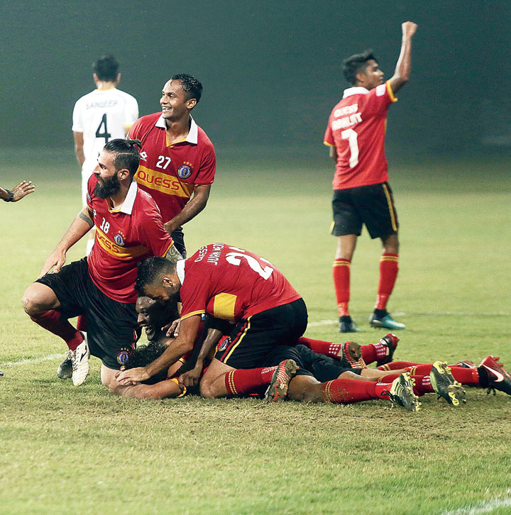 East Bengal players celebrate after the second goal against TRAU FC on Saturday.
