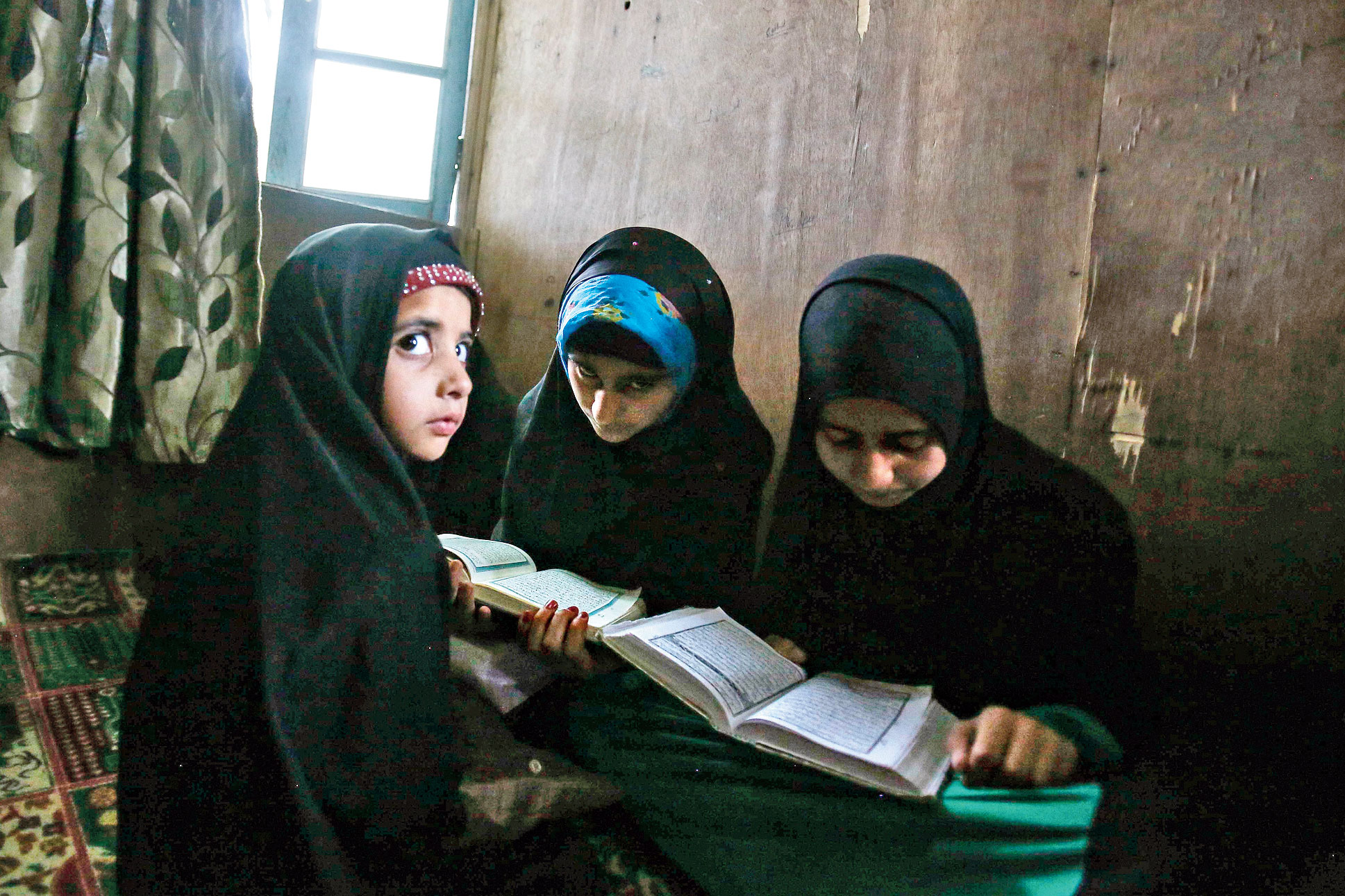 Kashmiri children attend recitation classes of the holy Quran on the  first day of Ramazan in Srinagar on May 7, 2019.