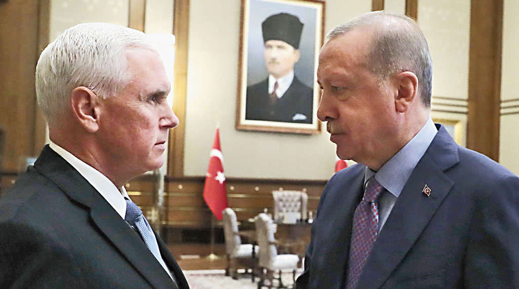 Turkish President Recep Tayyip Erdogan (right) with US Vice-President Mike Pence in Ankara on Thursday.
