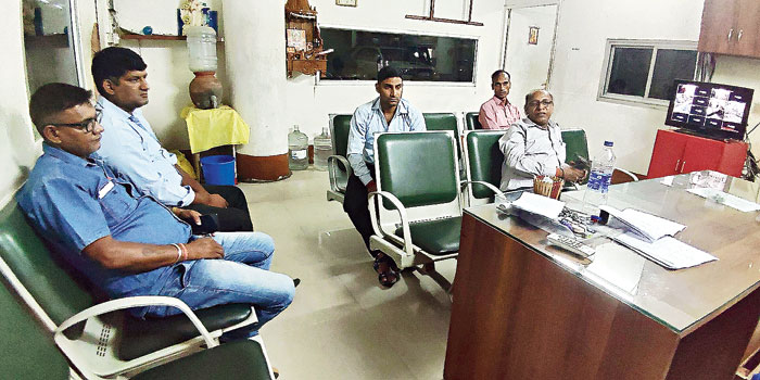 Employees of Mahesh Sunny Pvt Ltd, who came from Delhi but were not allowed to work, at the airport's parking bay office