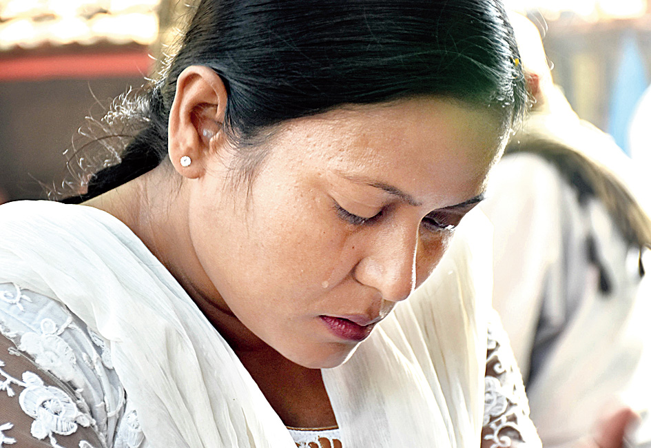 Putul Sarkar, the wife of the slain cop, weeps after hearing the verdict.
