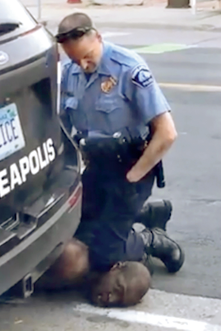 A picture taken from a video on May 25 by Darnella Frazier shows a Minneapolis police officer pressing his knee on George Floyd's neck who was handcuffed. Floyd later died.