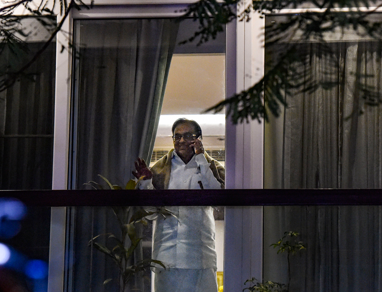 P. Chidambaram talks on the phone at his home following his release from jail in New Delhi on December 4. He was incarcerated for over 100 days in spite of the fact that he is yet to be convicted by a court