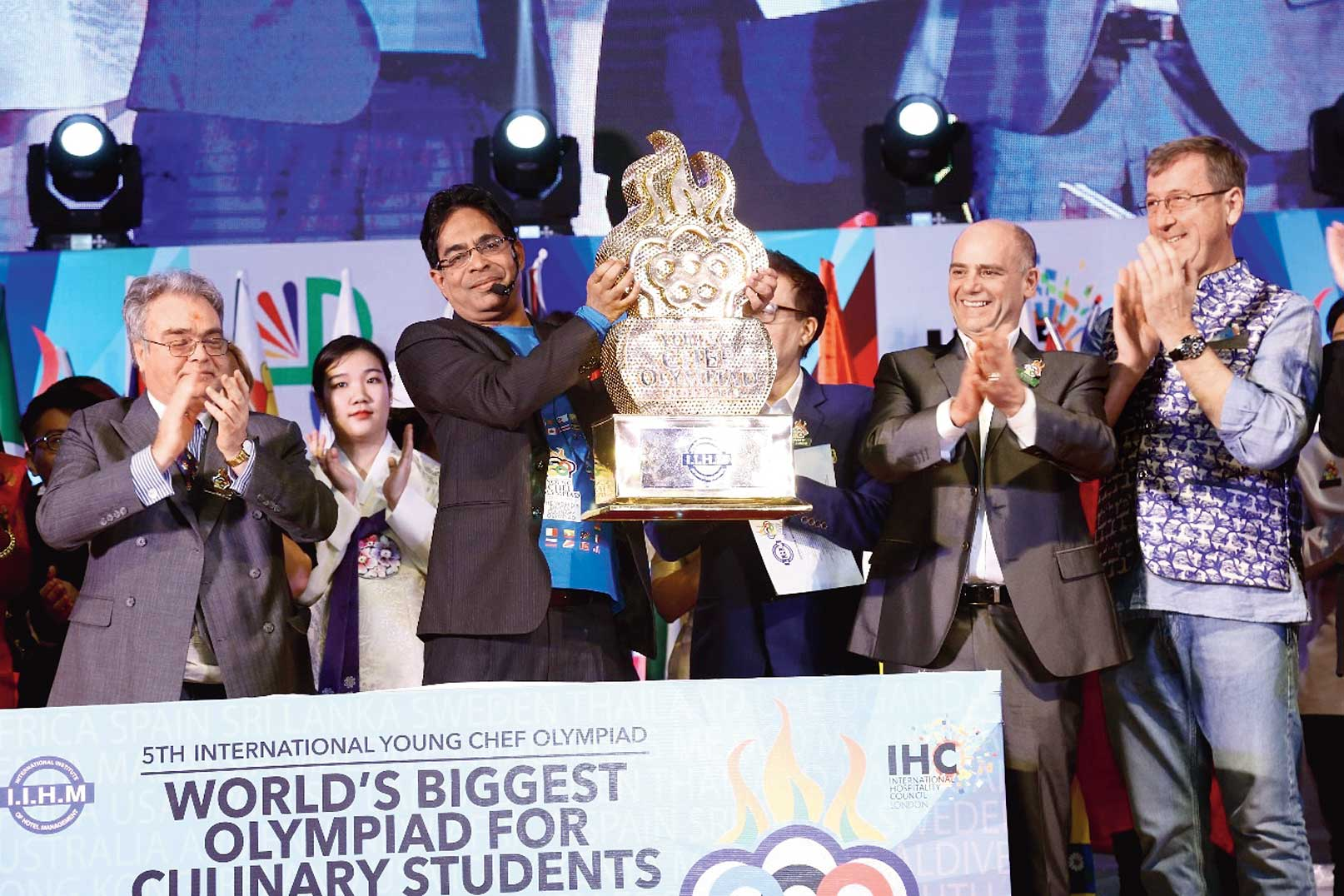 Suborno Bose unveils the IIHM YCO trophy that contestants from 50 countries will fight it out for