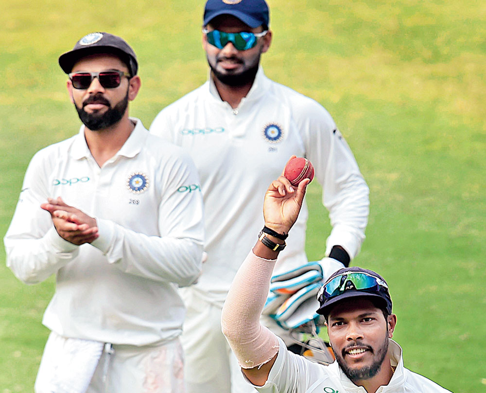 Umesh Yadav shows the ball as he walks off the field with teammates after the end of the 2nd innings of West Indies during Day 3 of the second cricket test match, in Hyderabad, Sunday, Oct 14, 2018