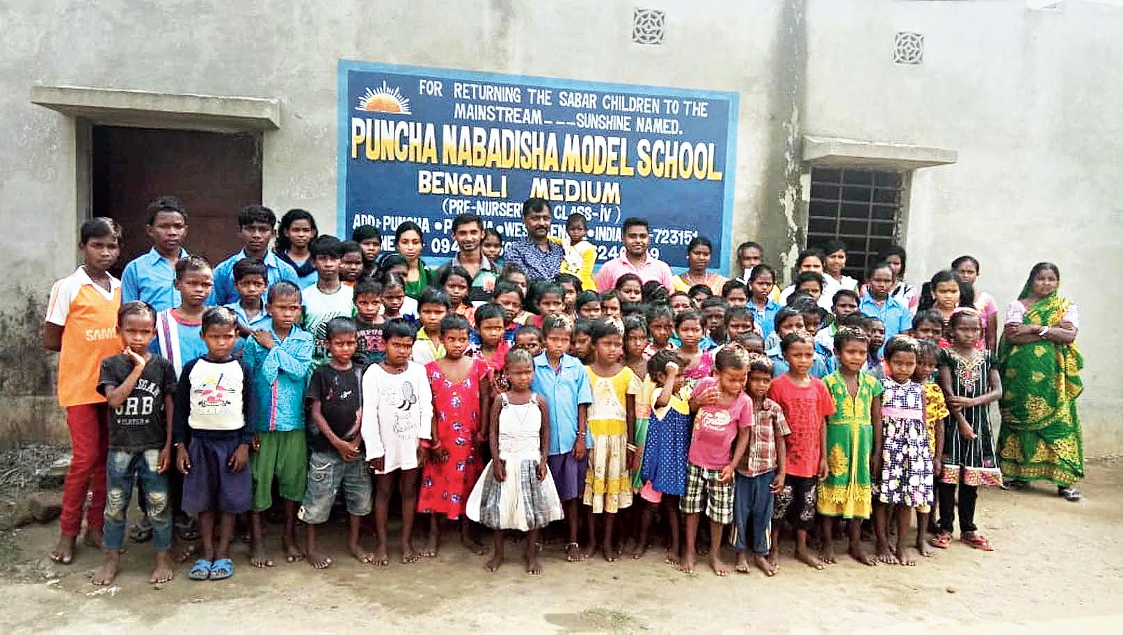 Students and staff of Puncha Nabadisha Model School outside the school building.