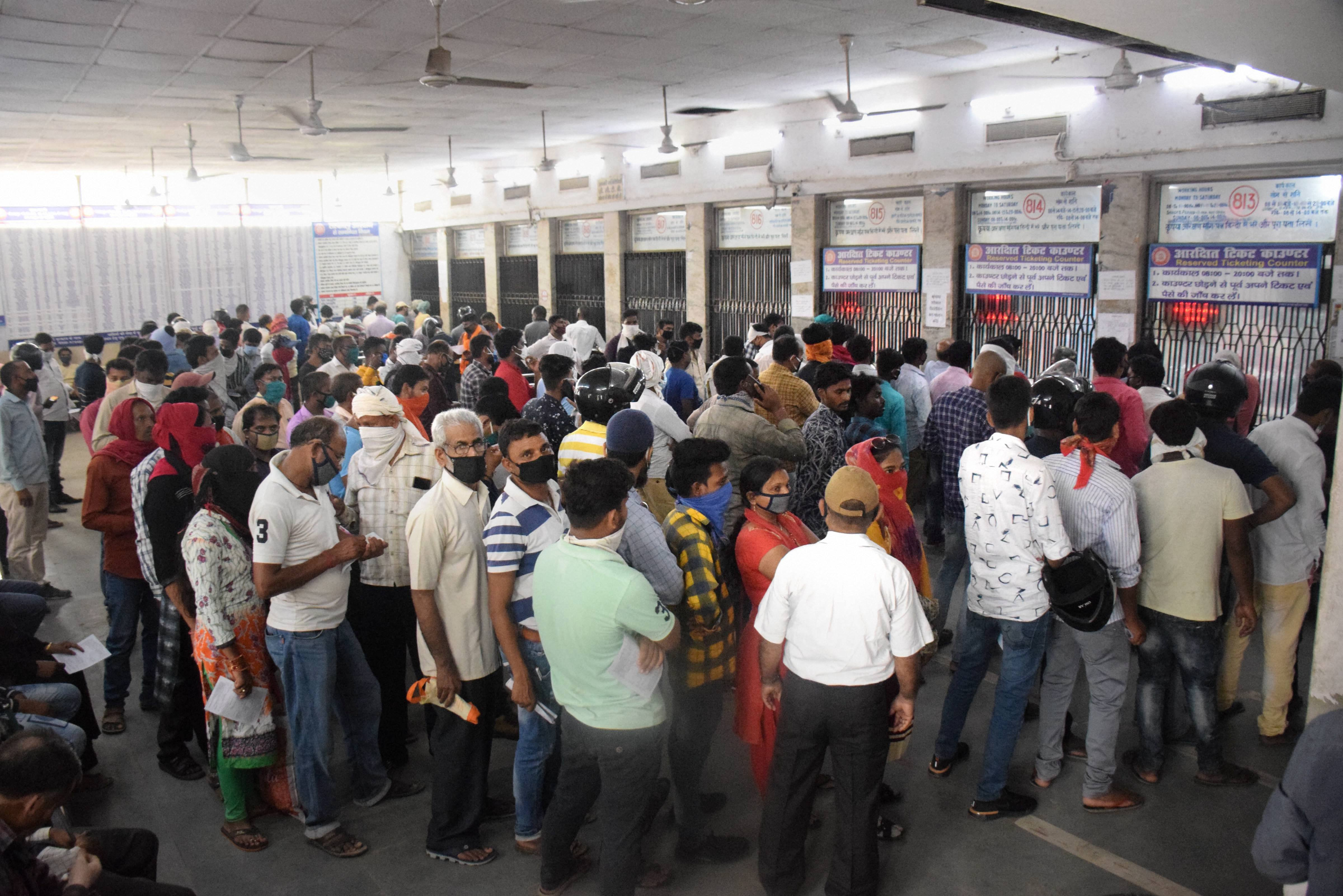 People flout social distancing norms as they stand in a queue infront of railway ticket counters, during the ongoing COVID-19 nationwide lockdown, in Gorakhpur, Tuesday, June 2, 2020.