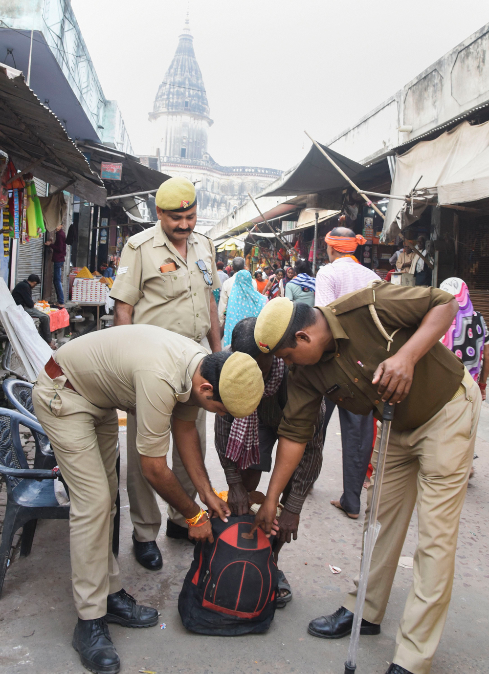 Police personnel check a bag in Ayodhya on Thursday
