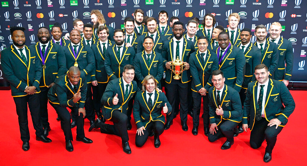South Africa's captain Siya Kolisi, center, holding the Webb Ellis Cup and teammates pose for a group photo, ahead of the World Rugby Awards ceremony in Tokyo, Sunday, November 3, 2019.