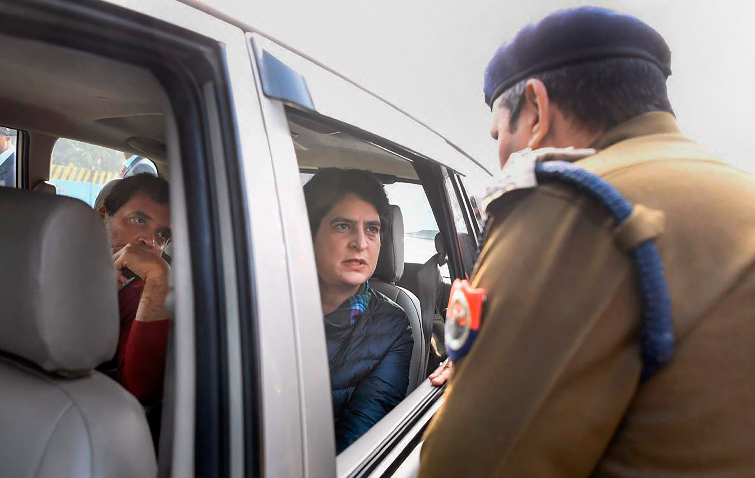 A police officer stops Rahul Gandhi and Priyanka Gandhi Vadra from entering Meerut on Tuesday. Barred by Uttar Pradesh police, Rahul and Priyanka talked to the families on the phone and returned to Delhi.