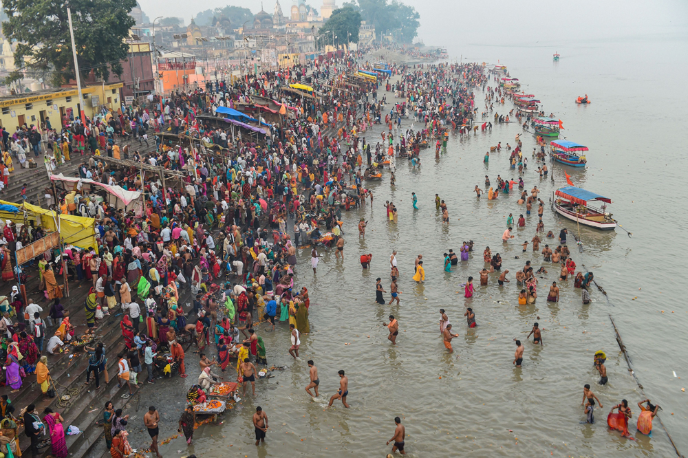 Devotees gather at an Ayodhya ghat to take a dip on the occasion of Kartik Purnima on Tuesday