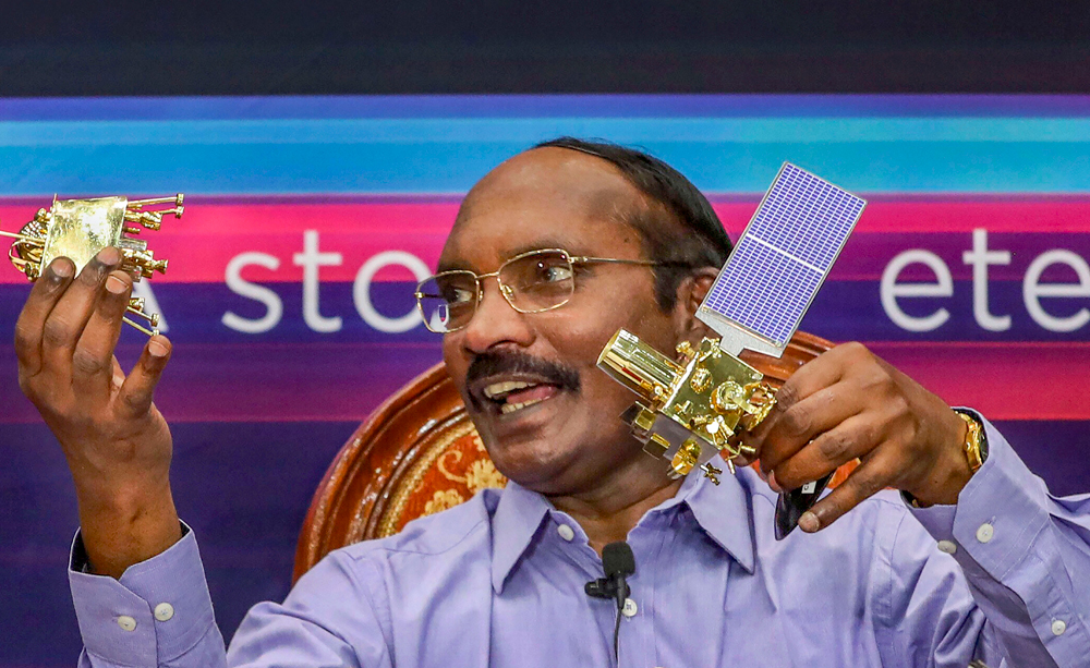 In this August 20, 2019 file photo, ISRO Chairman K. Sivan displays a model of Chanrayaan 2 orbiter and rover during a press conference in Bangalore.