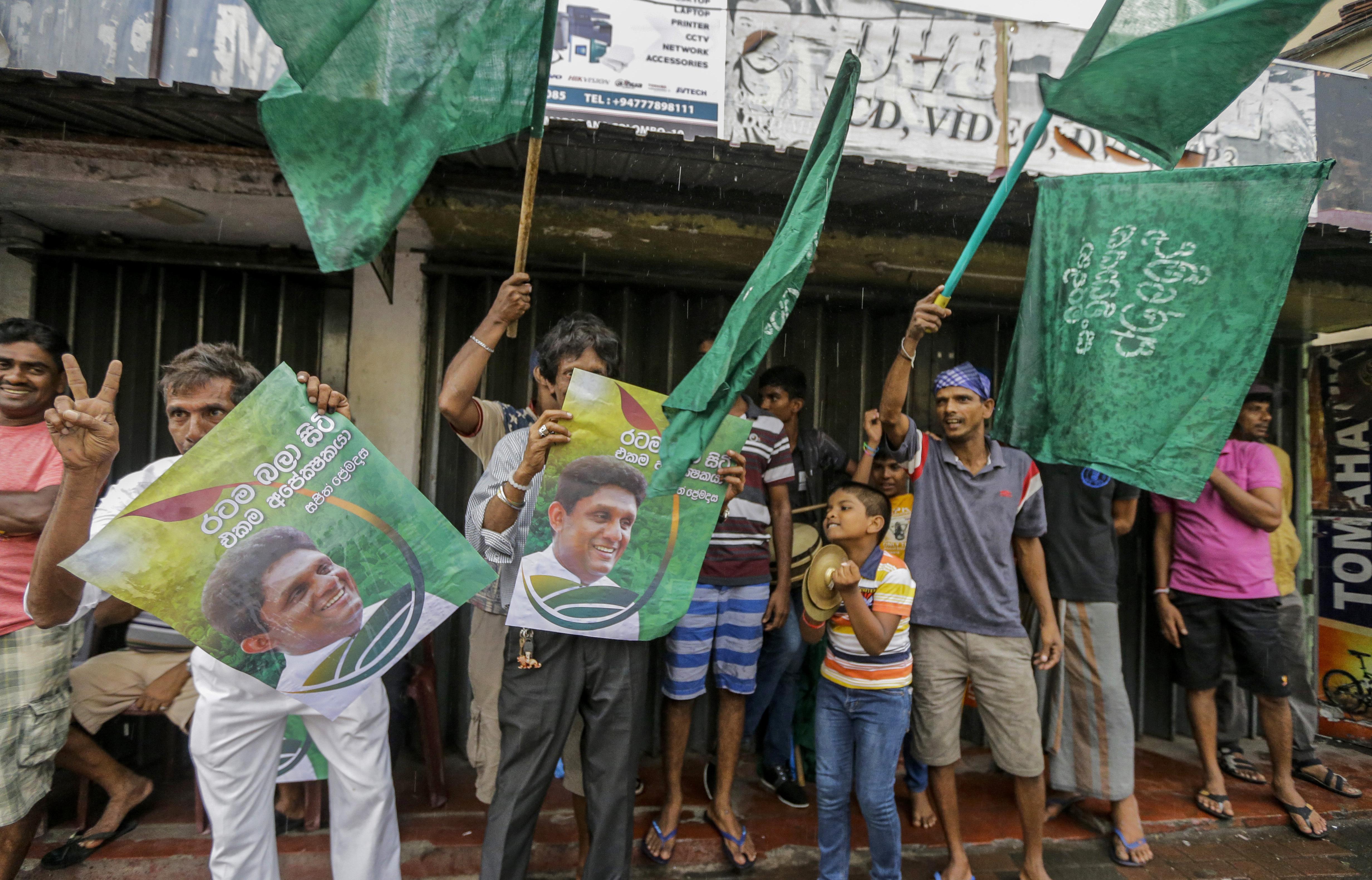 Supporters of Sri Lanka's governing party Presidential candidate Sajith Premadasa celebrate at the end of voting in Colombo, Sri Lanka, Saturday, November 16 , 2019