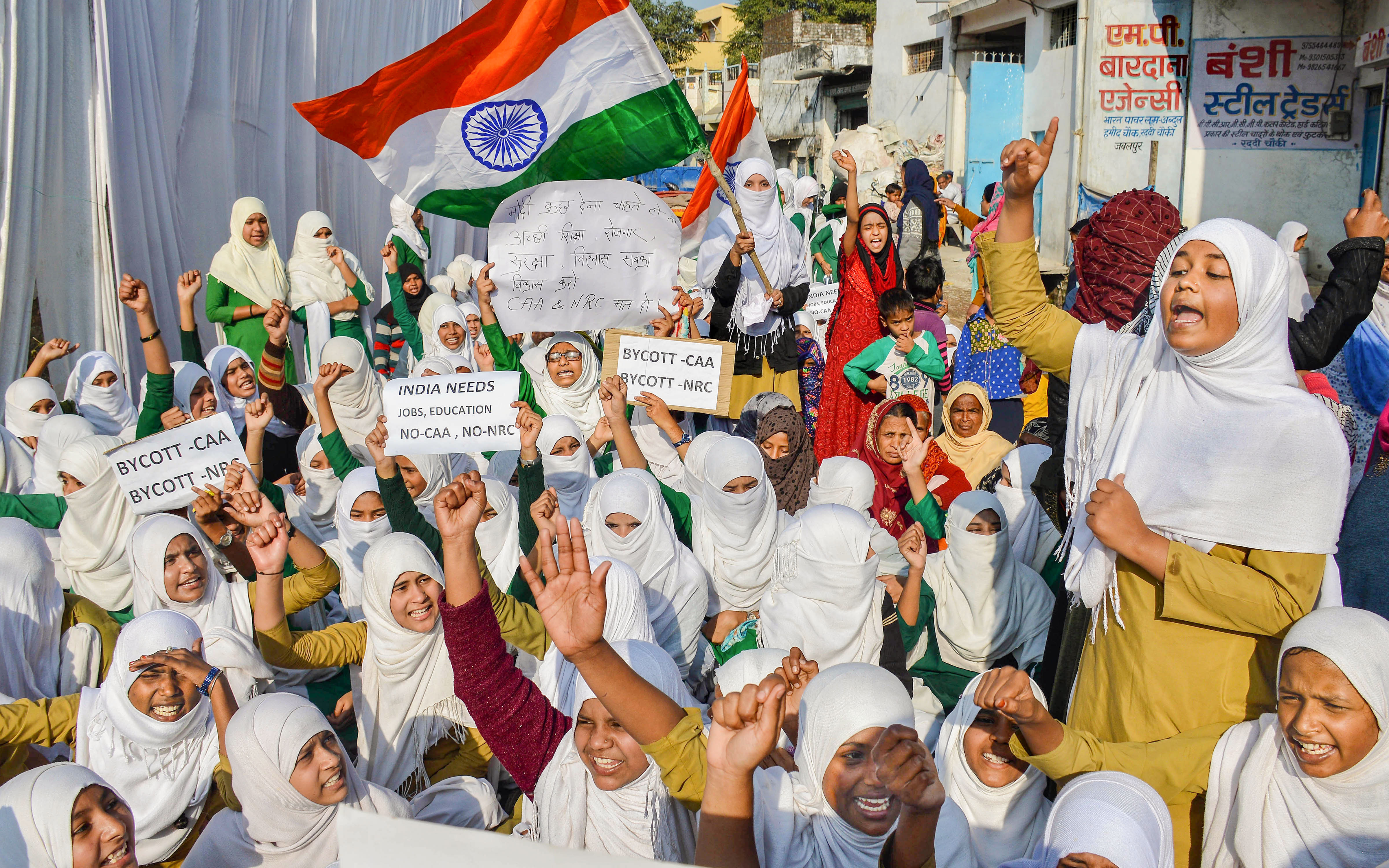 Muslims students hold placards during the fourth day of their protest against CAA and NRC, at Raddi Chowk in Jabalpur, Thursday, Jan, 23, 2020.