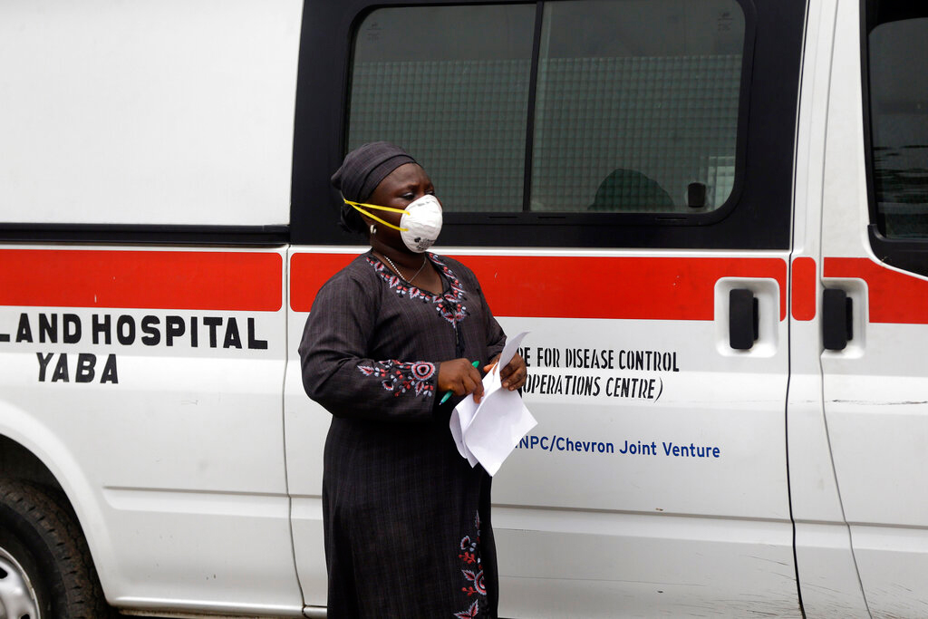 A woman wearing a mask in Lagos, Nigeria, on Friday. The opportunity could arise from countries in Southeast Asia, Africa and CIS, where Chinese goods had considerable presence