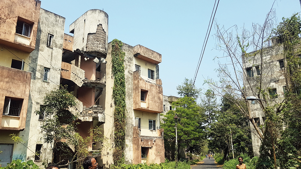 Many buildings in the quarters are in a shambles, with staircases and balconies having collapsed