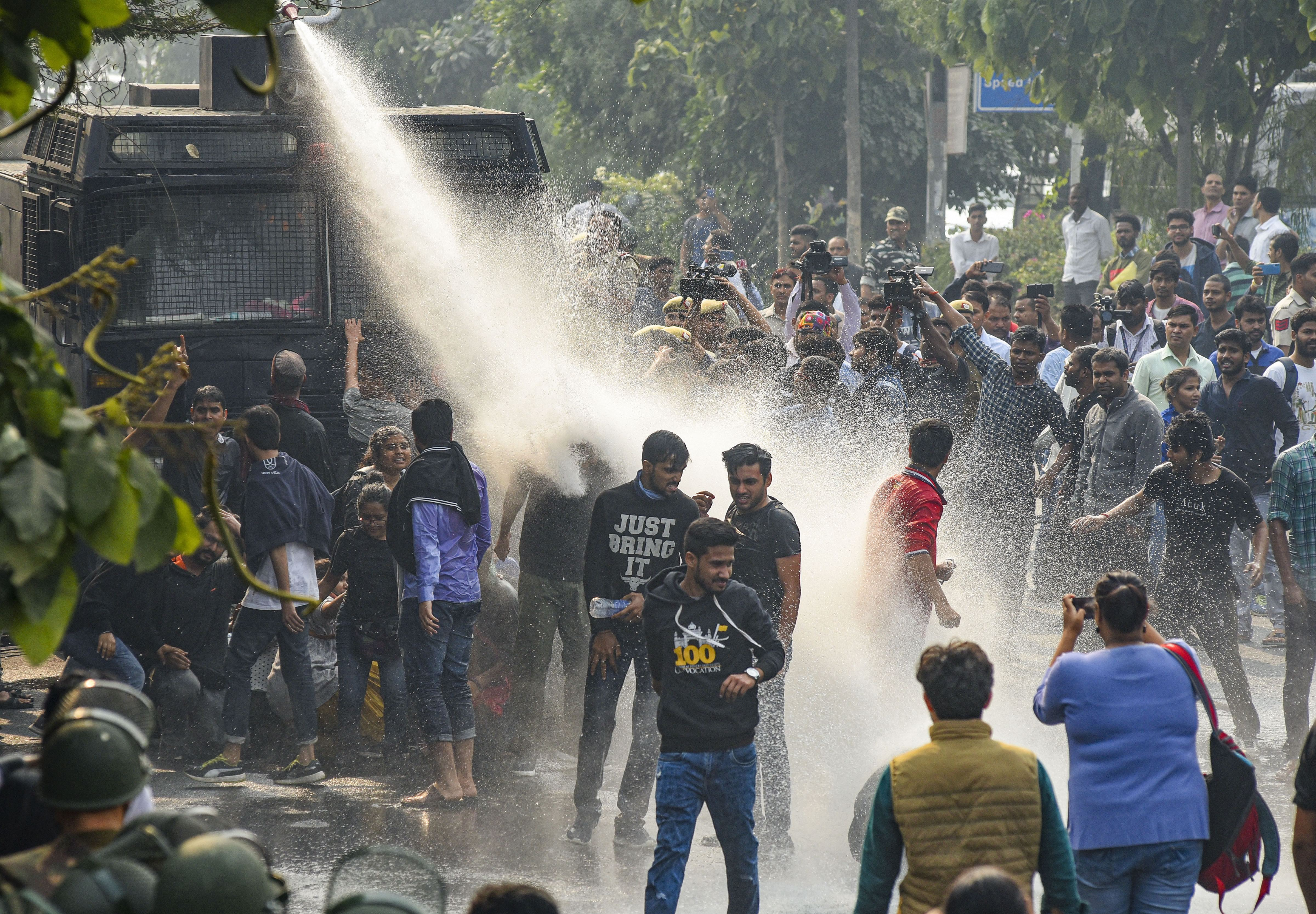 Police personnel use water cannon to disperse students of Jawaharlal Nehru University protesting against the administration's anti-students policy, in New Delhi, Monday, November 11, 2019.