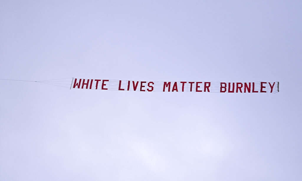 A plane towing a banner reading White Lives Matter Burnley flies above the stadium during the during the English Premier League match between Manchester City and Burnley on Monday