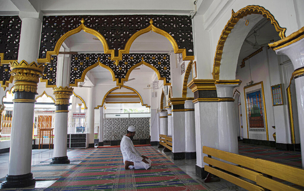 A Muslim man prays in a mosque during the nationwide lockdown to prevent the spread of new coronavirus in Gauhati, on Monday, April 27, 2020.