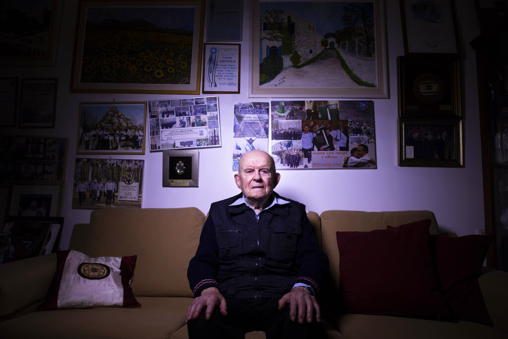 Mordechai Ciechanower, a 95-year-old Auschwitz survivor, poses for a photo in his home in Ramat Gan, Israel