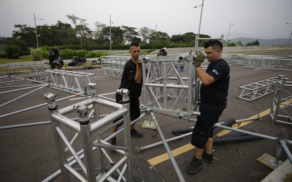 Workers build the stage for the upcoming concert, spearheaded by Richard Branson, on the Colombian side of the Tienditas International Bridge on the outskirts of Cucuta on the border with Venezuela on Monday.