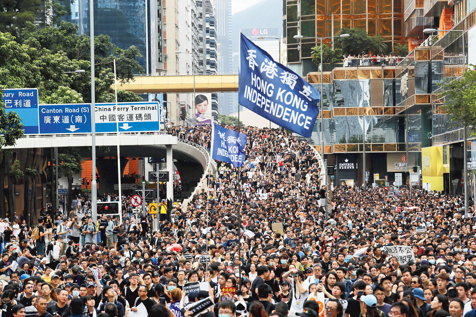 Carrying a banner calling for Hong Kong's independence, protesters flood the streets on Sunday.