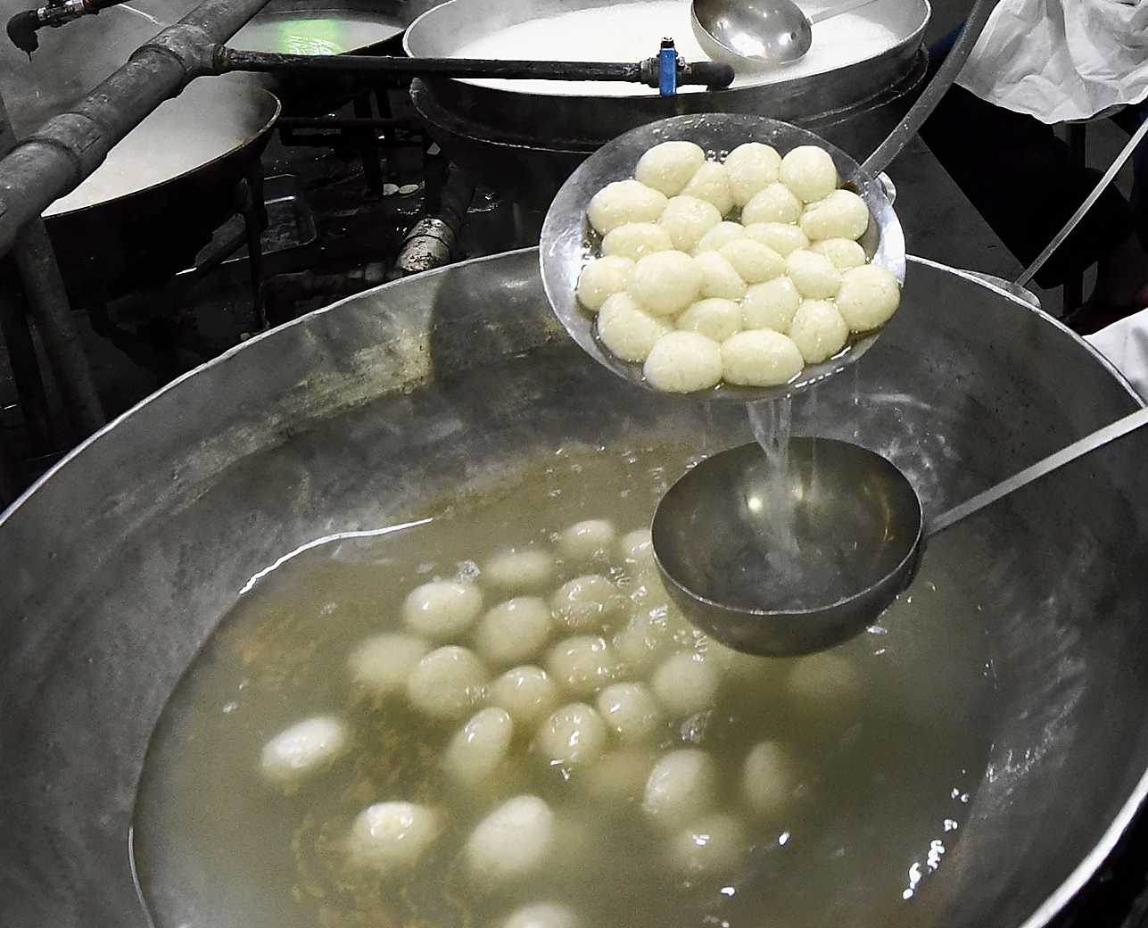 Rosogollas being soaked in sugar syrup at a shop in north Calcutta's Bagbazar