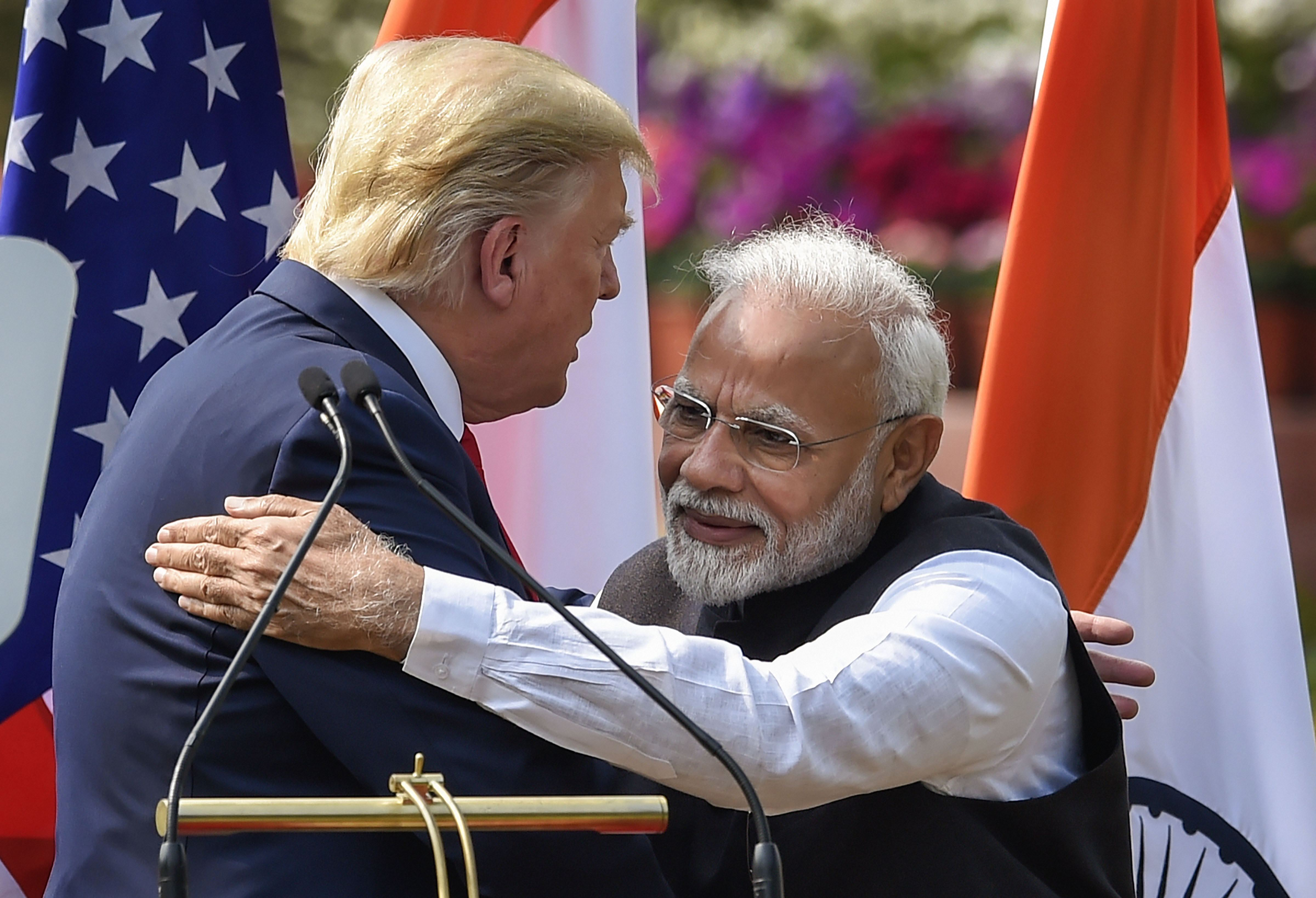 Prime Minister Narendra Modi (R) and US President Donald Trump hug each others after their joint press statement, at the Hyderabad House in New Delhi, Tuesday, February 25, 2020