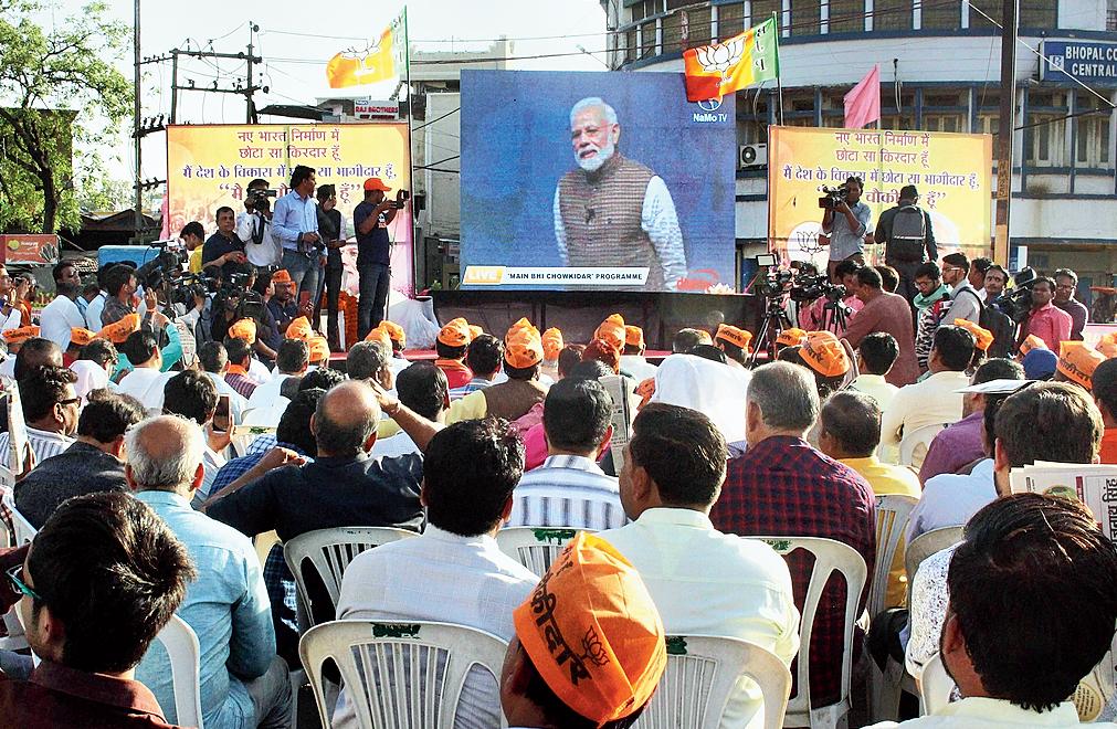 BJP workers in Bhopal watch the live telecast of Modi's Main Bhi Chowkidar programme.