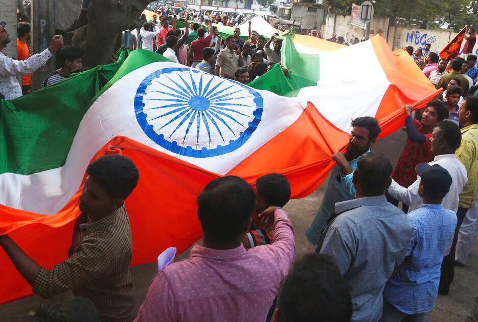 Supporters of Akhand Bharat Sangarsh Samithi carry a 75 meters long national flag during a rally supporting the implementation of the Citizenship Amendment Act in Hyderabad, Sunday, February 2, 2020.