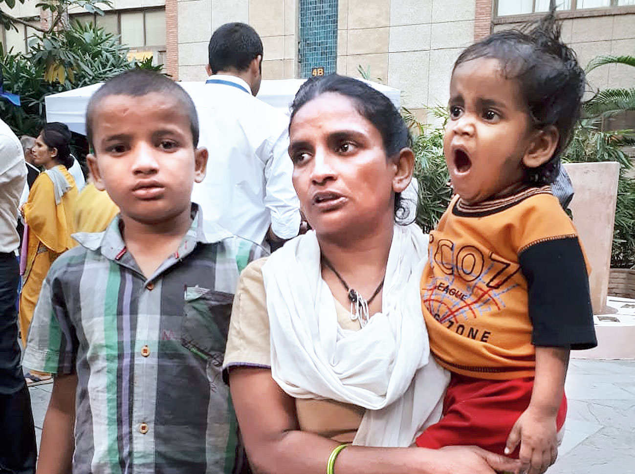 Rani with two of her children at the India Sanitation Forum on Saturday.