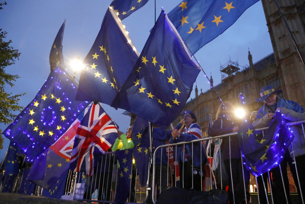 Pro EU protesters wave flags opposite Parliament in London on Monday, September 9, 2019.