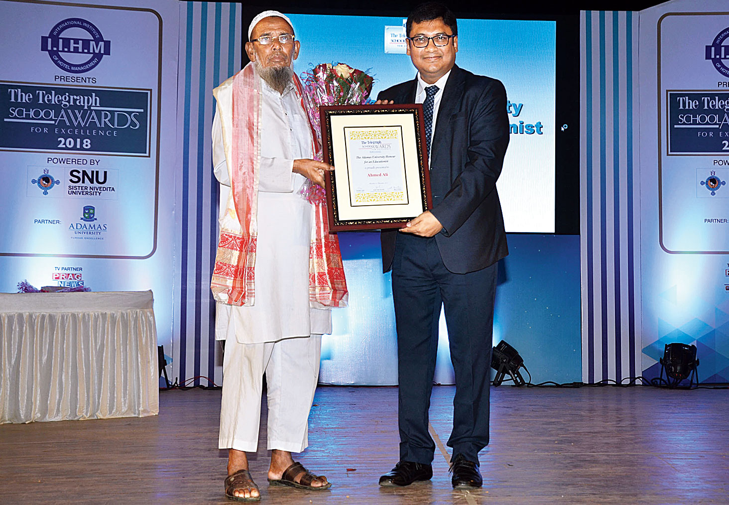 Ahmed Ali being honoured with the Adamas University Honour for Educationist by Adamas University vice-president Avijit Giri.
