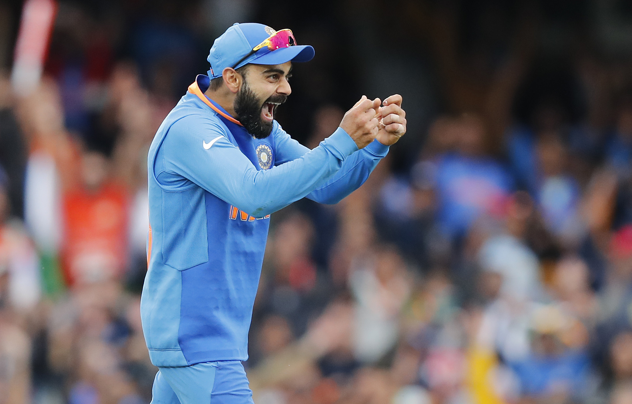 India's captain Virat Kohli celebrates after winning the match between India and Australia at the Oval in London on June 9.