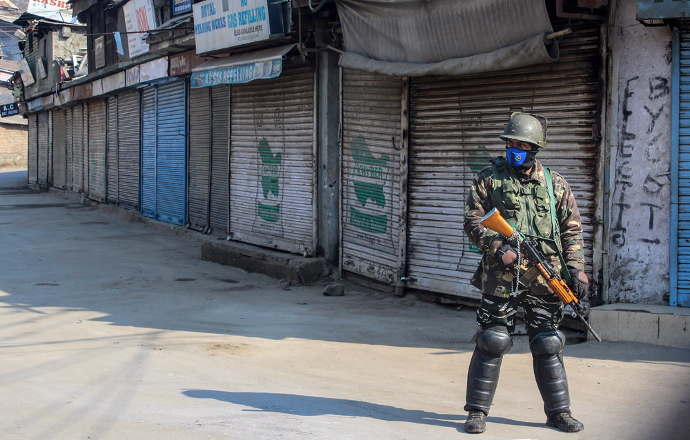 A trooper stands guard in Srinagar on Sunday