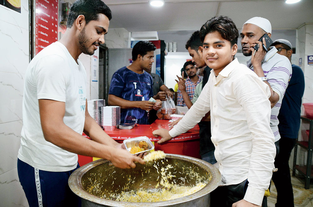 People savour Iftar delicacies at Konka Road in Ranchi on Tuesday evening
