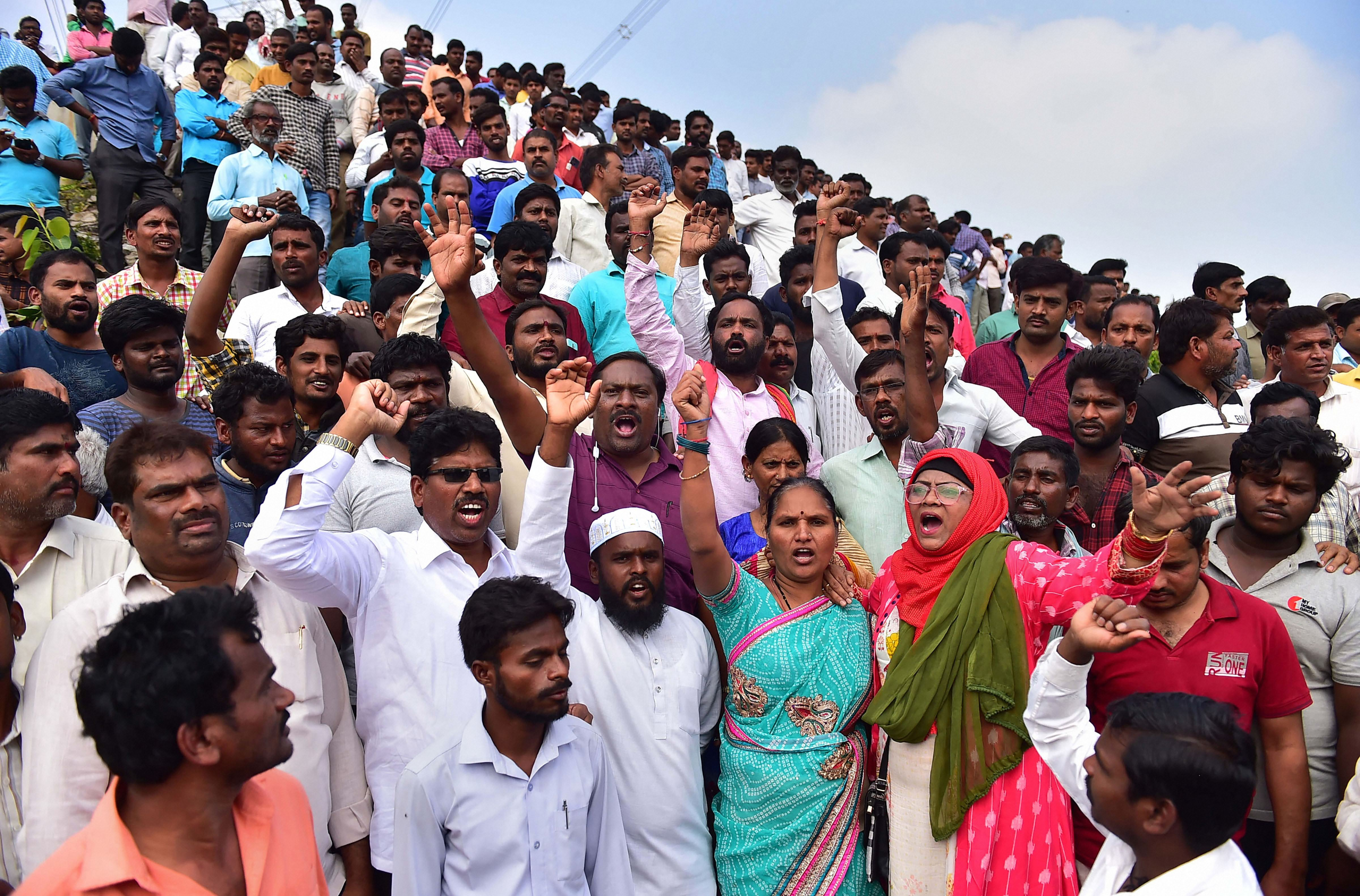 People raise slogans in favour of Hyderabad police at the encounter site, where four accused in the rape and murder case of a woman veterinarian were shot dead by police, at Shadnagar of Ranga Reddy district in Hyderabad, Friday, December 2019