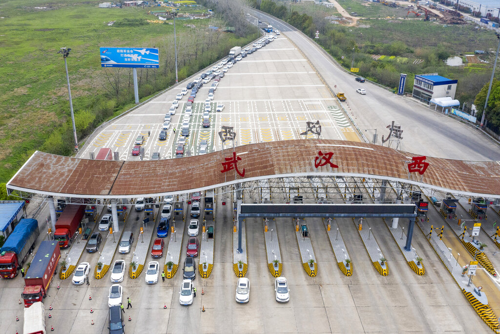 An aerial photo shows vehicles waiting to cross into Wuhan at a highway toll station in Wuhan, in central China's Hubei Province