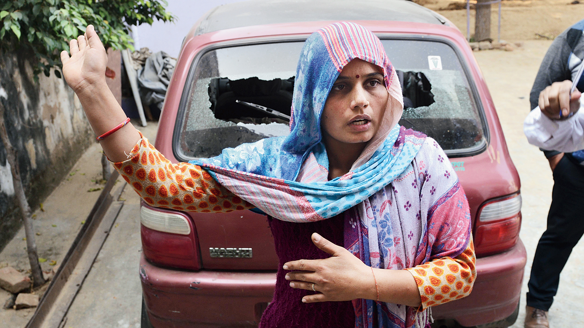 Preeti, the wife of Raj Kumar Chowdhury, in whose field the cow carcasses were found, at Mahav village in Bulandshahr on Tuesday.