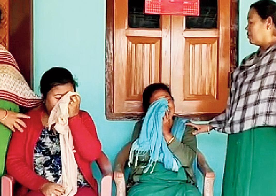 Maneswar Basumatary's family members mourn at his home in Tamulpur.