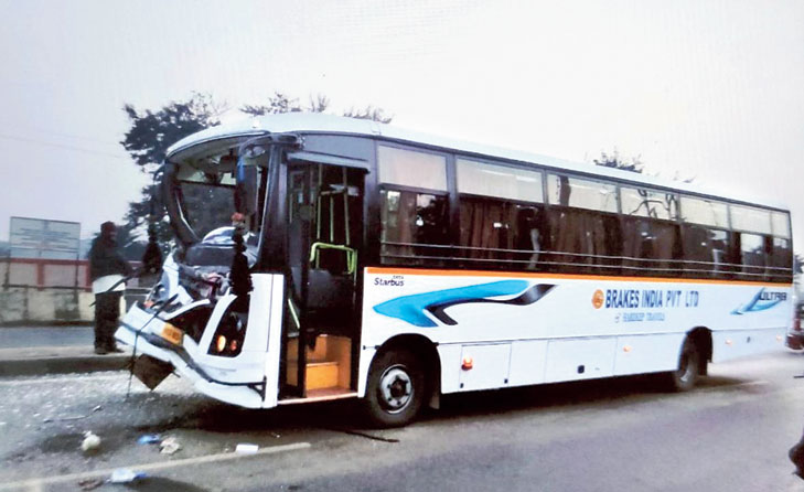 The damaged bus in Adityapur on Friday