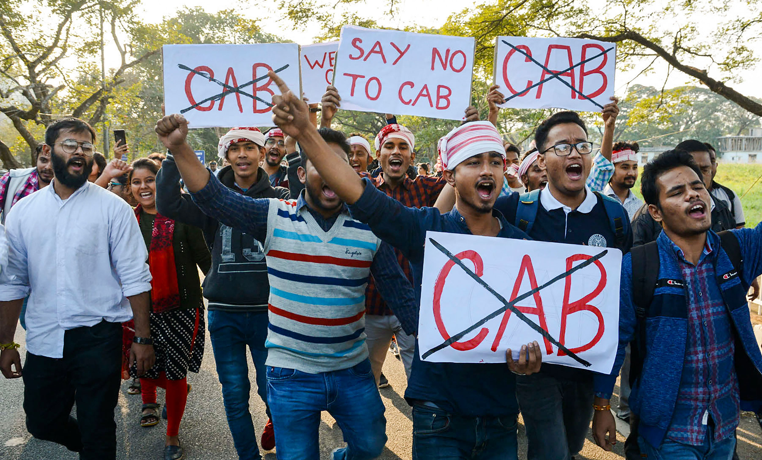 Gauhati University students hold placards as they raise slogans against Citizenship Amendment Bill in Guwahati on Monday.